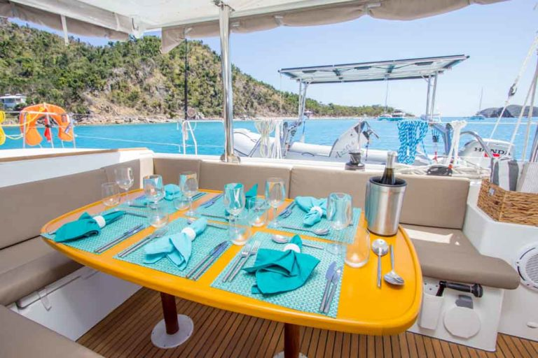 Azuria alfresco dining, fresh air vacations, caribbean charters, crewed yachts, turquoise water, regency yacht vacations